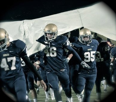 Varsity-football-team-running-out